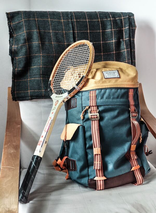 Old fashioned backpack and tennis racket